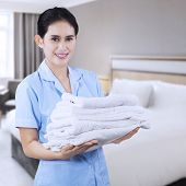 Pretty Maid Hotel With Towels