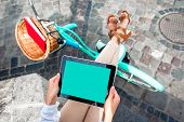 foto of toothless smile  - Holding tablet in the hands with bicycle on background in the city - JPG