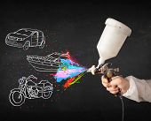 picture of air paint gun  - Man with airbrush spray paint with car - JPG