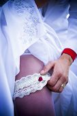 Garter Bride Leg And Bridegroom Hand With Gold Ring