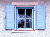 Vintage Traditional  Window With Blue Shutters