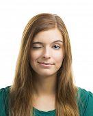 Portrait of a beautiful young woman blinking eye