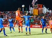Sisaket Thailand-august 13: Watsapol Thosantia Of Sisaket Fc. (orange) In Action During Thai Premier