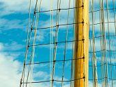 Yacht Mast Against Blue Summer Sky. Yachting