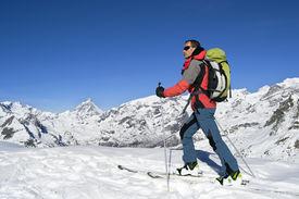 stock photo of italian alps  - Ski mountaineering cross country skiing in Italian Alps - JPG