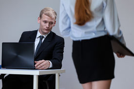 stock photo of inappropriate  - Man observing female co - JPG