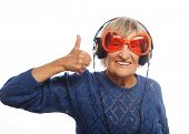 image of old lady  - Funny old lady listening music and showing thumbs up - JPG