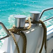 foto of bollard  - bollard with coiled rope on board ship - JPG