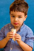 a little boy eating a banana. representative photo of food