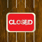 Closed Sign Hanging On A Wooden Fence