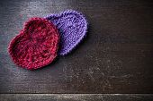 picture of orifice  - Knitted red and purple hearts - JPG
