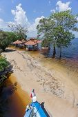 image of neglect  - Sand beach width neglected cabins in Rio Negro - JPG