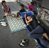 BANGKOK, THAILAND - DECEMBER 25, 2014: Street Photography of homeless refugees from Cambodia.