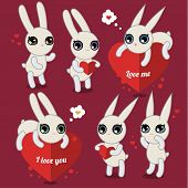 Cute white rabbits on pink