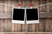 Two Old Picture Frame Hanging On The Clothesline