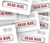 Snail Mail words in envelopes to illustrate slow, old-fashioned traditional hand delivery of messages and communication