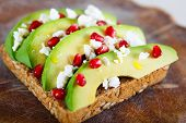 Avocado With Feta, Pomegranate On Sunflower Seeds Bread Sandwich.
