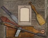 vintage kitchen utensils over wooden board, blank card for your text
