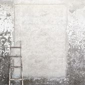 weathered wall with a wooden ladder