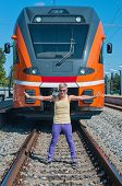 Young trendy guy in front of train