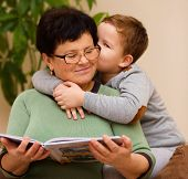 Grandmother Is Reading Book With Her Grandson