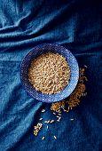 Oat grains in a ceramic bowl