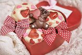 stock photo of red velvet cake  - Red velvet cupcakes decorated with hearts for Valentines day - JPG