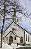 image of dartmouth  - An old Anglican Church surrounded by leafless trees  in Dartmouth Nova Scotia - JPG