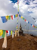 foto of ganesh  - view from Langtang to Ganesh Himal with stupa and prayer flags and beautiful clouds  - JPG