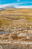 Norway Nature Mountain Landscape With Stones And Lake.