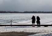 People Looking Out At Lake Ontario In The Winter