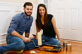 Young couple working on painting their home together