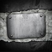 iron plate on concrete wall
