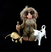 picture of troll  - A troll figurine with a brass armadillo and a cow cream dispenser - JPG