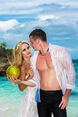 Bride And Groom Drink Coconut Water On A Tropical Beach