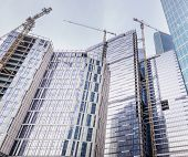 Tower Cranes Build Large Residential And Office Buildings.