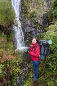 Girl Tourist Photographs Waterfall. Portugal Monchique, Chilrao.