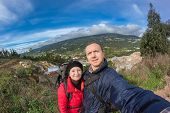 Young Family Hiking In The Mountains. With A Backpack In Portugal Monchique.