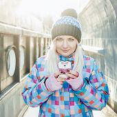 Texting blonde woman winter outdoors