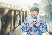 Texting smiling blonde woman winter outdoors