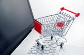 Internet Shopping Concept. Basket On Laptop Keyboard