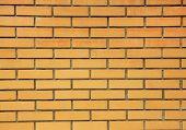 Orange brick wall close-up background