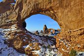 pic of arch  - Turret Arch seen through North Window Arch in Arches National Park Utah in winter - JPG