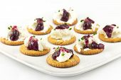 Crackers With Cream Cheese Grape Jelly And Chives