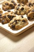 Chocolate Chip Cookies On Wood Table