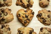 foto of chocolate-chip  - Chocolate chip cookies with heart shape on wood table  - JPG