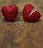 Broken heart on wood background