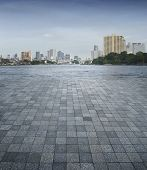 An Empty Scene Of A Stone Tile Floor And Bangkok City