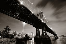 stock photo of tribute  - New York City downtown and september 11 tribute at night with Manhattan Bridge - JPG