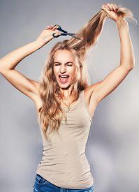 image of split ends  - Woman cut her hair - JPG